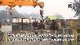 Watch: Delhi Police deploy JCB machine to dig road at Singhu border