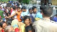 Watch People queue up for food packets, water bottles in flood-affected Patna