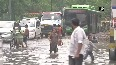 Children in Delhi play in waterlogged roads after downpour