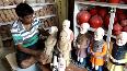 Muzaffarpur-based sculptor carves statue of PM Narendra Modi to use as money storage bank