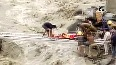 Locals, disaster rescue team carries injured person across raging Jahalman nallah in Lahaul Spiti