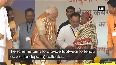 Watch: PM Modi presents a pair of slippers to a tribal woman