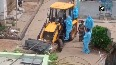 COVID patient's body taken to graveyard on JCB in Andhra