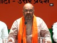 Amit shah says modi will be the next pm, targets ec