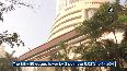 Equity gauges end flat after volatile session, Titan dips 4.5 pc
