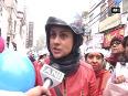 Women s wing of aap organises bike rally as a show of strength in krishna nagar