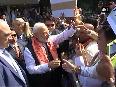 PM Modi greets Indian community outside his hotel