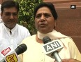 I am keen to see how modi govt implements its tall promises mayawati