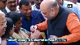 Amit Shah gives polio drops to child on Pulse Polio Day