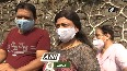 COVID-19 People stand in queue outside Mumbais NESCO vaccination centre