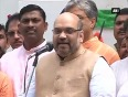 Bjp president amit shah hoists national flag at party headquarters
