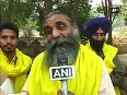 Farmers hold silent march against GM mustard seeds