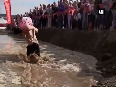 Watch Couples compete in Maine s annual wife-carrying contest