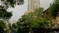 Equity indices close flat after volatile session, UPL up 7%