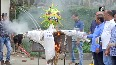 BJP workers burn corona effigy to celebrate launch of COVID-19 vaccination drive