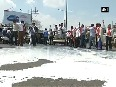 Watch Farmers protest by pouring milk on road