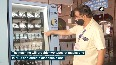 Vending machine installed at Dadar Railway Station provides masks, sanitisers to commuters.mp4