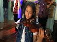 Underprivileged children performing