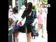 Liv tyler suffers wardrobe malfunction as wind lifts her dress