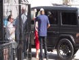 (Video) Kim Kardashian Butt Too Big For Her Tight Skirt | Can 't Get Out Of Her Car!