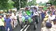 RJD's Tejashwi Yadav drives a tractor in protest against farm bills
