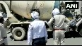 18 migrants caught travelling in cement mixing truck to UP