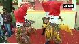 NAMASTE TRUMP School children perform near Ahmedabad airport