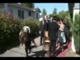 Girl falls in wedding party video