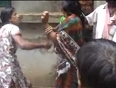 23-jul- two women catch hold of a woman thief and give her a beating in the streets of town in andhra pradesh